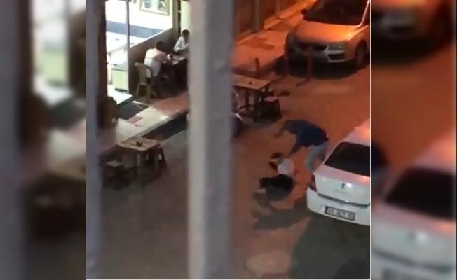 Sokak ortasında kadına tekme tokat işkence