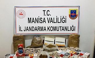Demirci'de kaçak tütün ve sigara operasyonu