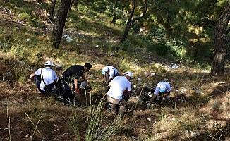 Öğretmenler orman yangınına sebep olabilecek atıkları topladı